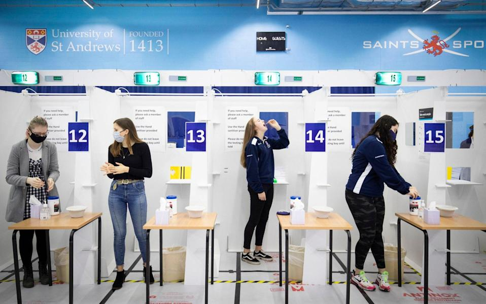 Students get a Covid-19 test at a mass testing centre set up at the sports centre at St Andrews University, ahead of the Christmas holiday - PA