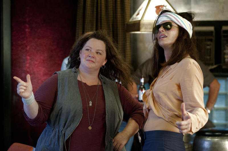 """This film publicity image released by 20th Century Fox shows Sandra Bullock as FBI Special Agent Sarah Ashburn, right, and Melissa McCarthy as Boston Detective Shannon Mullins in a scene from """"The Heat."""" (AP Photo/20th Century Fox, Gemma La Mana)"""