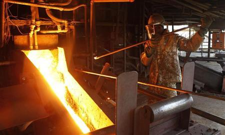 An employee works at a platinum smelter at Selous Metallurgical Complex near Harare