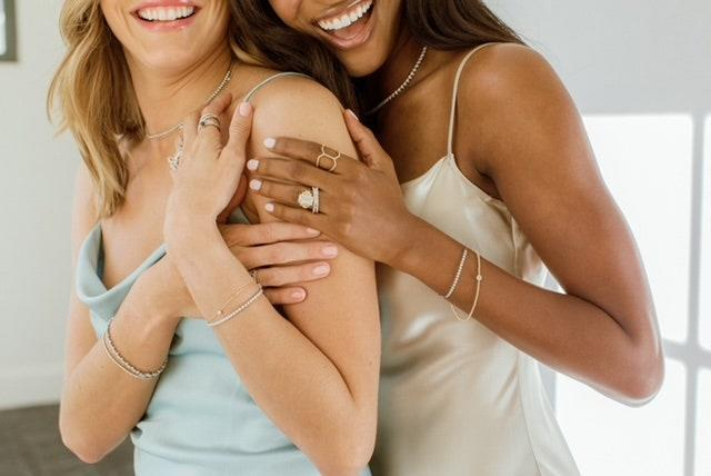 """<p>Diamond Aupair is a private jewellery designer specialising in everything from engagement rings and redesigning heirloom pieces to unique fine fashion jewellery. Designer, Hallie Swope, aims to make quality, custom jewellery more attainable than ever with her integrated online shopping experience. <a href=""""https://diamondaupair.com/collections"""" rel=""""nofollow noopener"""" target=""""_blank"""" data-ylk=""""slk:diamondaupair.com"""" class=""""link rapid-noclick-resp"""">diamondaupair.com</a></p> <p><em>Follow them on Instagram</em> <a href=""""https://www.instagram.com/diamondaupair/"""" rel=""""nofollow noopener"""" target=""""_blank"""" data-ylk=""""slk:@diamondaupair"""" class=""""link rapid-noclick-resp""""><em>@diamondaupair</em></a></p>"""