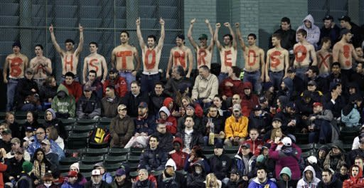 "Fans with painted letters on their bare chests spell out ""Bahston Red Sox!"" during a baseball game against the Oakland Athletics at Fenway Park in Boston on a chilly Tuesday, May 1, 2012. (AP Photo/Elise Amendola)"