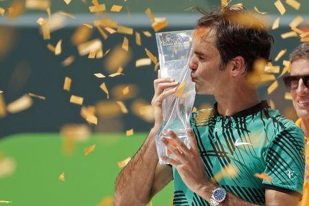 Apr 2, 2017; Key Biscayne, FL, USA; Roger Federer of Switzerland kisses the Butch Buchholz trophy after his match against Rafael Nadal of Spain (not pictured) in the men's singles championship of the 2017 Miami Open at Crandon Park Tennis Center. Mandatory Credit: Geoff Burke-USA TODAY Sports