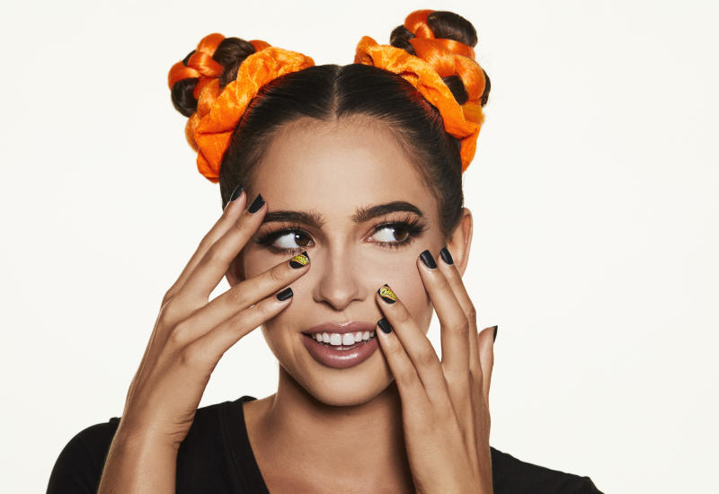 Cheetos puts its orange-dusted fingerprints all over fashion and beauty world with