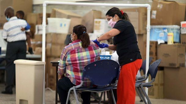 FILE PHOTO: Anna Mendez, LPN, administers Moderna COVID-19 vaccine at a clinic set up by Healthcare Network on May 20, 2021 in Immokalee, Fla. (Joe Raedle/Getty Images)