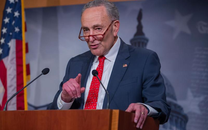 Democratic Senate Minority Leader Chuck Schumer speaks to the media after the Senate passed the Coronavirus Aid, Relief, and Economic Security Act - Shutterstock