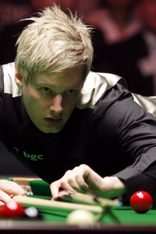 Australia's Neil Robertson lines up a shot during a frame against England's Shaun Murphy during the final of the BGC masters snooker tournament at Alexandra Palace in London on January 22, 2012. AFP PHOTO / JUSTIN TALLIS (Photo credit should read JUSTIN TALLIS/AFP/Getty Images)