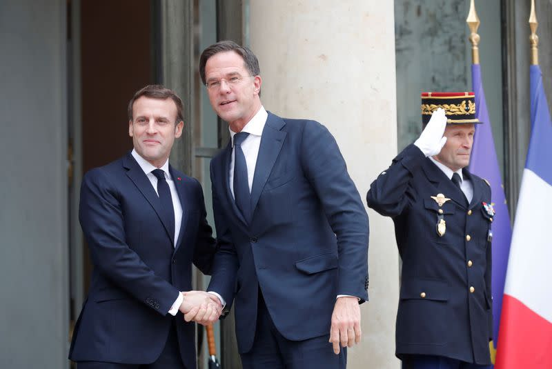 FILE PHOTO: French President Emmanuel Macron welcomes Dutch Prime Minister Mark Rutte at the Elysee Palace in Paris