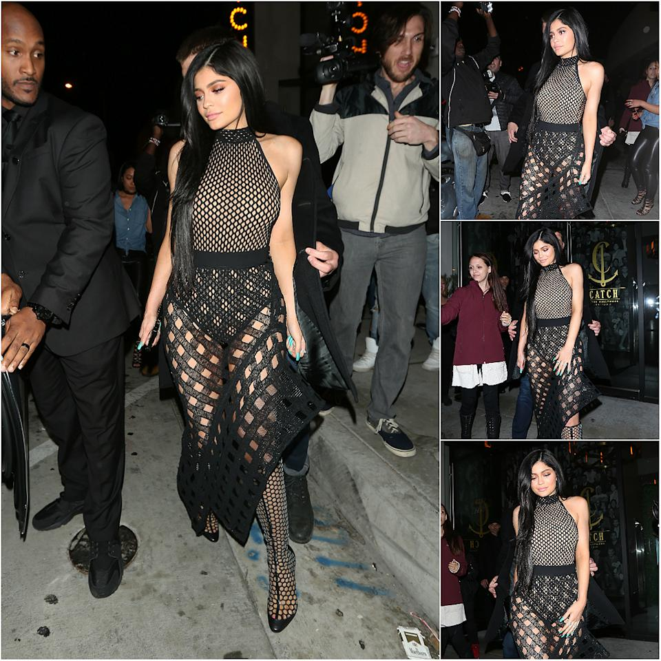 <div><b>When: March 11, 2017</b> <br />Kylie Jenner flashed her long legs in a form-fitting fishnet body suit and a very sheer black mesh skirt as she graced Catch restaurant in West Hollywood for dinner Saturday night. The asymmetrical skirt was cinched at the waist to showcase her Monroe-esque figure and curvy frame. She complemented the look with mesh knee-high boots, flowing raven locks and rust-red eye shadow. <i> (Photos: Splash News)</i> </div>