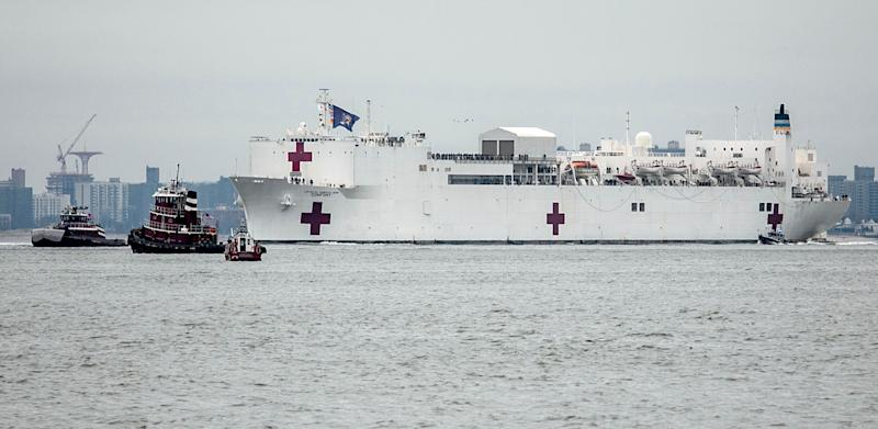 The Navy hospital ship USNS Comfort sails into New York on March 30. The ship initially planned to help treat non-coronavirus patients while hospitals treat people with COVID-19. (Photo: ASSOCIATED PRESS)