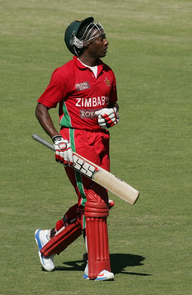 Zimbabwe batsman Vusimuzi Sibanda walks off the pitch after loosing his wicket during the first of five ODI series match between India and Zimbabwe at the Harare Sports Club on 24 July, 2013. AFP PHOTO / JEKESAI NJIKIZANA        (Photo credit should read JEKESAI NJIKIZANA/AFP/Getty Images)