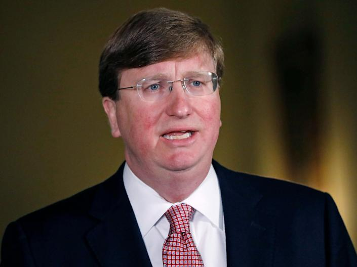 <p>Mississippi Republican Gov Tate Reeves delivers a televised address prior to signing a bill retiring the last state flag in the United States with the Confederate battle emblem</p> (Getty Images)