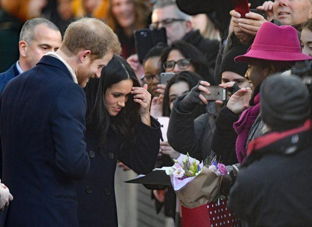 Ms Markle was given flowers by well-wishers (Victoria Jones/PA)