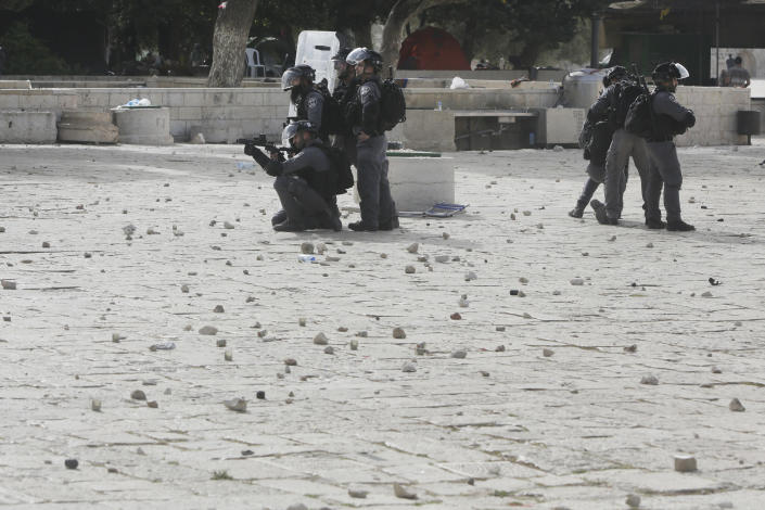 Israeli security forces take positions during clashes with Palestinians in front of the Dome of the Rock Mosque at the Al Aqsa Mosque compound in Jerusalem's Old City, Monday, May 10, 2021. Israeli police clashed with Palestinian protesters at a flashpoint Jerusalem holy site on Monday, the latest in a series of confrontations that is pushing the contested city to the brink of eruption. Palestinian medics said at least 180 Palestinians were hurt in the violence at the Al-Aqsa Mosque compound, including 80 who were hospitalized. (AP Photo/Mahmoud Illean)