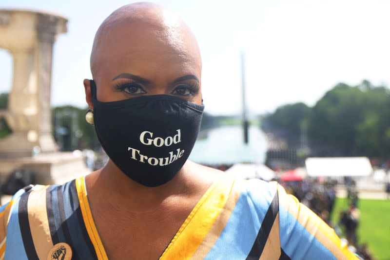 FILE PHOTO: 'Get Your Knee Off Our Necks' march in support of racial justice, in Washington