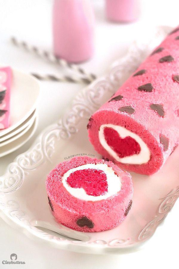 "<p>Feel the love with this heart-filled cake roll. Every slice gives you a beautiful bright pink heart, matched with smaller chocolate hearts on the exterior. </p><p><strong>Get the recipe at <a href=""http://cleobuttera.com/cakes/love-is-all-around-cake-roll/"" rel=""nofollow noopener"" target=""_blank"" data-ylk=""slk:Cleobuttera"" class=""link rapid-noclick-resp"">Cleobuttera</a>.</strong></p>"