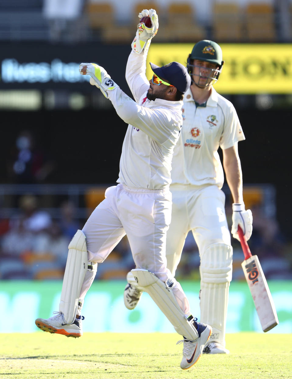 India's wicketkeeper Rishabh Pant catches the ball during play on the first day of the fourth cricket test between India and Australia at the Gabba, Brisbane, Australia, Friday, Jan. 15, 2021. (AP Photo/Tertius Pickard)