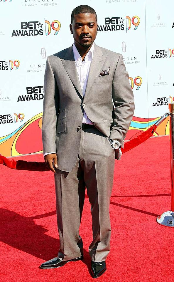 "Reality star Ray J struck a pose in a crisp white shirt and gray suit. Maury Phillips/<a href=""http://www.wireimage.com"" target=""new"">WireImage.com</a> - June 28, 2009"