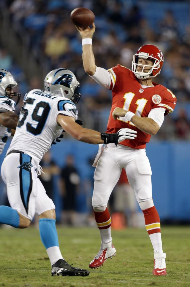 Kansas City Chiefs' Alex Smith (11) throws a pass under pressure from Carolina Panthers' Luke Kuechly (59) during the first half of an NFL preseason football game in Charlotte, N.C., Sunday, Aug. 17, 2014. (AP Photo/Bob Leverone)