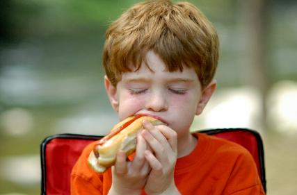 """<div class=""""caption-credit""""> Photo by: iStockphoto</div><div class=""""caption-title""""></div><b>Hot Dogs - 2.6% of food choking ER visits <br></b> Hot dogs are the same shape as a child's airway and a usual suspect to be blamed for choking. Even if you cut it in a coin, it's still the same shape as your child's throat. We halve, and then quarter lengthwise our veggie dogs when we pack them in our son's lunch. <br> <b><a rel=""""nofollow"""" href=""""http://www.babble.com/kid/10-tips-for-moms-things-dads-just-wish-youd-know-how-to-do/?cmp=ELP