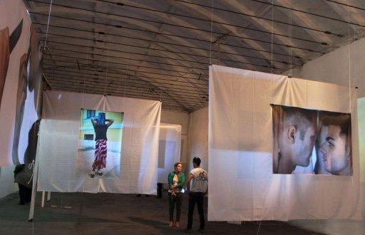 People visit the exhibition 'Hidenseek' organized by LGBT Albania