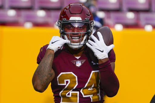 Washington Football Team running back Antonio Gibson (24) smiling as he celebrates his touchdown against the Cincinnati Bengals during the first half of an NFL football game, Sunday, Nov. 22, 2020, in Landover. (AP Photo/Susan Walsh)