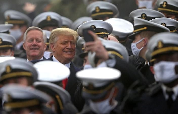 President Donald Trump smiles for a selfie with a Midshipmen from the U.S. Naval Academdy in Annapolis, Maryland, during the first half of the Army-Navy game at Michie Stadium in West Point, New York, Dec. 12, 2020.