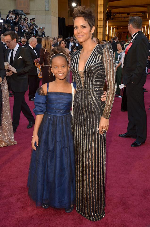 Quvenzhane Wallis and Halle Berry arrive at the Oscars in Hollywood, California, on February 24, 2013.