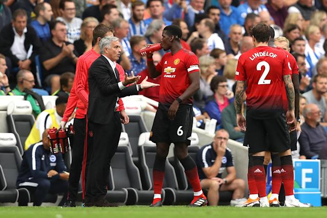 Jose Mourinho is animated during discussions with his players