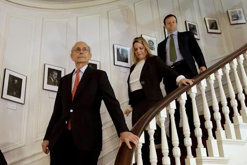 United States Supreme Court Justice Stephen Breyer, left, descends a stairway at the French Cultural Center followed by center members Mary Ann Sorel, center, and her husband Pierre Sorel, right, Monday, Feb. 13, 2017, in Boston. Breyer toured the French Cultural Center before participating in a forum called From the Bench to the Sketchbook. (AP Photo/Steven Senne)