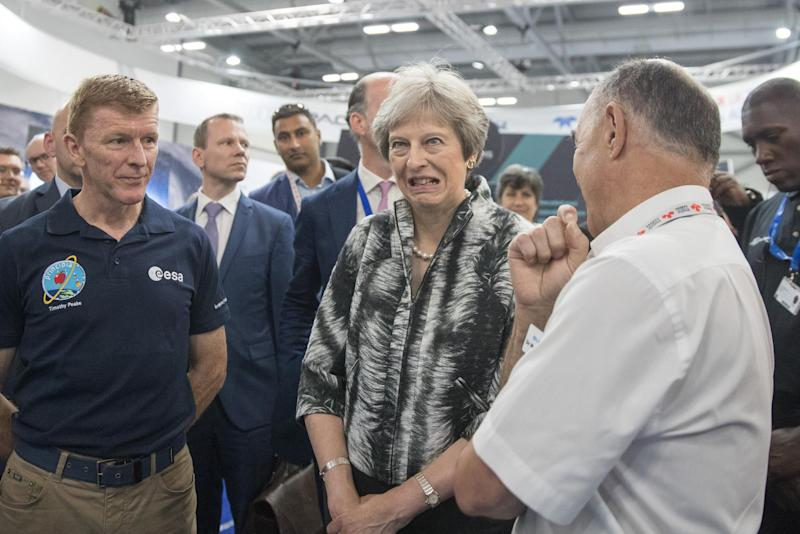 British Prime Minister Theresa May speaks with European Space Agency astronaut Tim Peake (L) as she opens the Farnborough Airshow on July 16, 2018 in Farnborough, England: Matt Cardy - WPA Pool/Getty Images