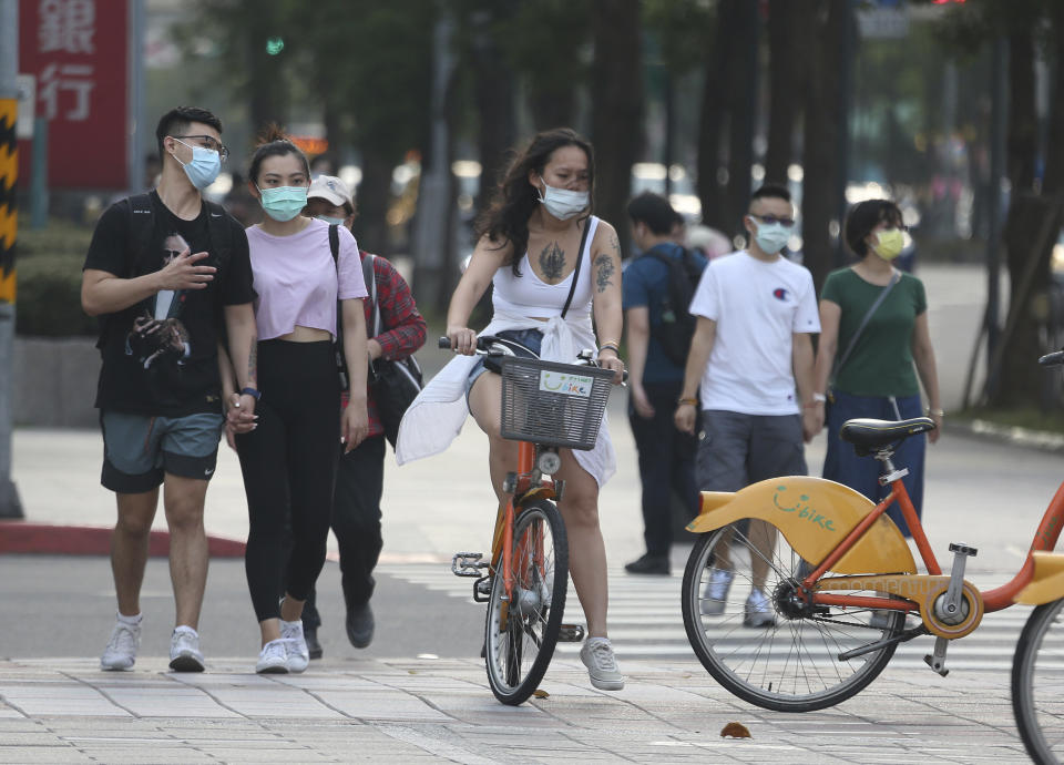 People wearing face masks in Taipei after cases surge in Taiwan. (AP Photo/Chiang Ying-ying)