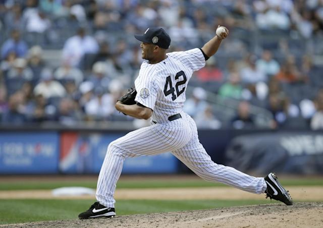 New York Yankees relief pitcher Mariano Rivera (42) delivers in the ninth inning of a baseball game against the San Francisco Giants, Sunday, Sept. 22, 2013, in New York. (AP Photo/Kathy Willens)