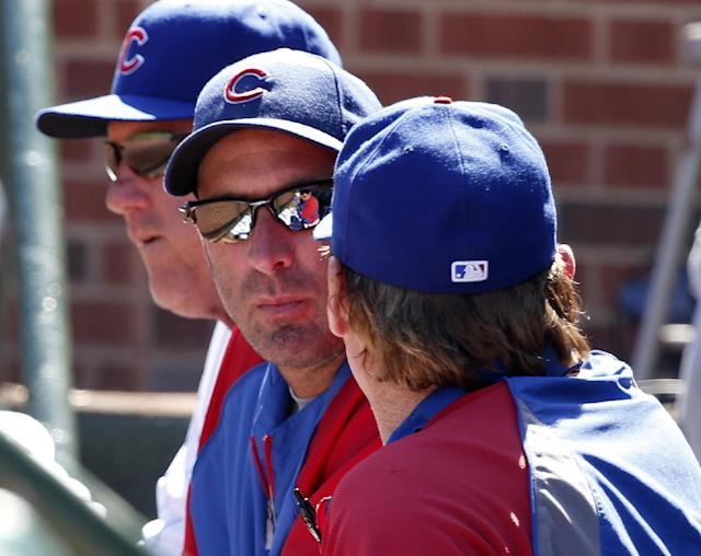 Chicago Cubs manager Dale Sveum, center, listens to a coach before a baseball game against the Pittsburgh Pirates Wednesday, Sept. 25, 2013, in Chicago. (AP Photo/Charles Rex Arbogast)