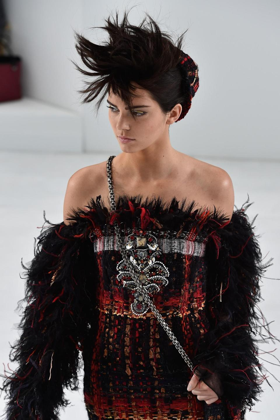 <p>Walking Chanel Haute Couture Fall/Winter 2014-2015 in Paris, Jenner sported a faux-hawk and silver eyeliner — earlier that year, she had walked in Chanel's Ready-to-Wear collection show. <i>(Photo: Getty Images)</i></p>