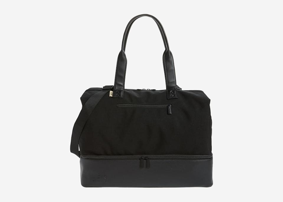 """<p>With a water-resistant and pocket-filled interior, plus an extra roomy bottom compartment that fits several pairs of shoes or those souvenirs you can't bear to leave behind, this understatedly chic tote has enough nooks and crannies to keep even the worst over-packer in line. And the structured frame opening on top keeps the bag wide open—or securely shut—when you need it to be.</p> <p><strong>Buy now:</strong> <a href=""""https://click.linksynergy.com/deeplink?id=mcB7N8bf3MY&mid=1237&u1=weekenderbags&murl=https%3A%2F%2Fshop.nordstrom.com%2Fs%2Fbeis-weekend-travel-tote%2F5305452"""" rel=""""nofollow noopener"""" target=""""_blank"""" data-ylk=""""slk:$98, nordstrom.com"""" class=""""link rapid-noclick-resp"""">$98, nordstrom.com</a></p>"""