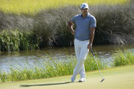 Brooks Koepka waits to putt on the 13th green during the first round of the PGA Championship golf tournament on the Ocean Course Thursday, May 20, 2021, in Kiawah Island, S.C. (AP Photo/Matt York)