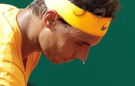 Tennis - ATP - Monte Carlo Masters - Monte-Carlo Country Club, Monte Carlo, Monaco - April 18, 2018 A bead of sweat drops off of Spain's Rafael Nadal as he prepares to serve during his second round match against Slovenia's Aljaz Bedene REUTERS/Eric Gaillard