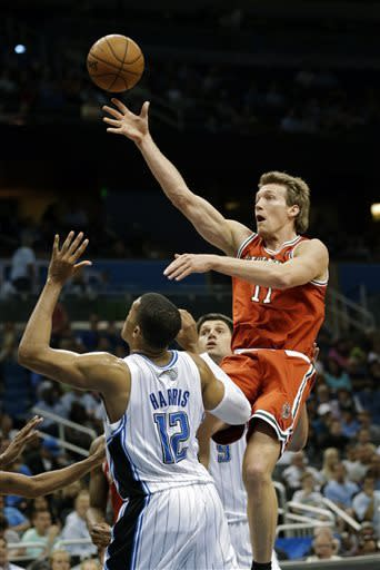 Milwaukee Bucks' Mike Dunleavy, right, shoots over Orlando Magic's Tobias Harris (12) during the first half of an NBA basketball game, Wednesday, April 10, 2013, in Orlando, Fla. (AP Photo/John Raoux)