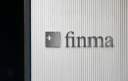 FILE PHOTO: The logo of Swiss Financial Market Supervisory Authority FINMA is seen outside their headquarters in Bern