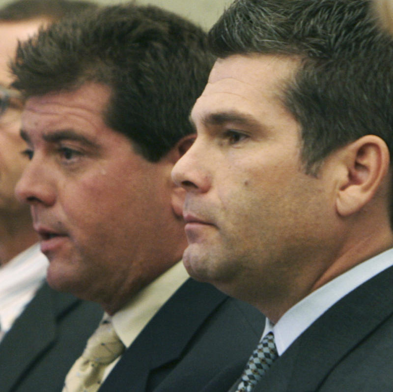 FILE - In this Sept. 29, 2006 file photo, Michael Derderian, left, and brother Jeffrey Derderian stand in Kent County Superior Court in Warwick, R.I., during a sentencing hearing for a 2003 fire at their West Warwick nightclub that killed 100 people.  Ten years later, the imprint of the fire remains - including in the state's strict fire code, passed soon after the blaze, that requires all nightclubs like The Station to install sprinklers. (AP Photo/Bob Breidenbach, Pool, File)