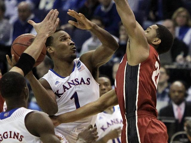Kansas' Wayne Selden, Jr., left, shoots as Stanford's Anthony Brown defends during the first half of a third-round game of the NCAA college basketball tournament Sunday, March 23, 2014, in St. Louis. (AP Photo/Jeff Roberson)