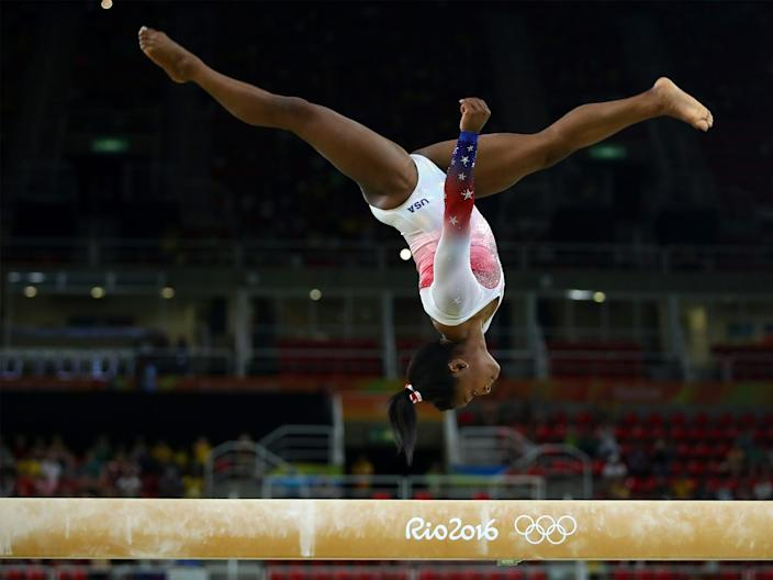 Simone Biles performs on the beam during the 2016 Rio Olympic Games