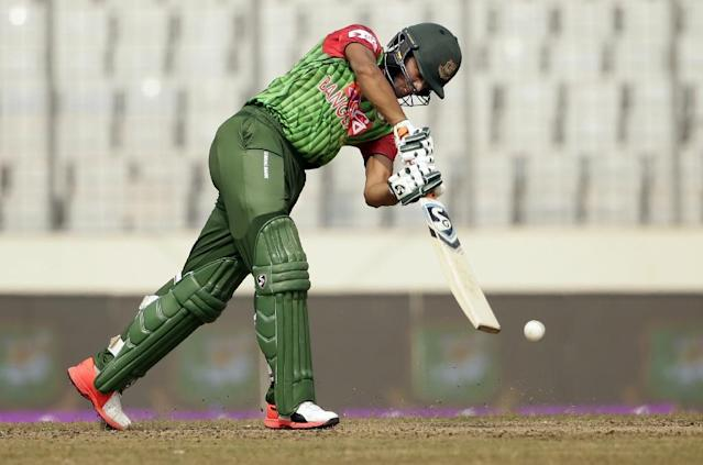 Bangladesh cricketer Shakib Al Hasan plays a shot during the fifth one day international (ODI) cricket match in the Tri-Nations Series between Sri Lanka and Zimbabwe at the Sher-e-Bangla National Cricket Stadium in Dhaka on January 23, 2018 (AFP Photo/-)