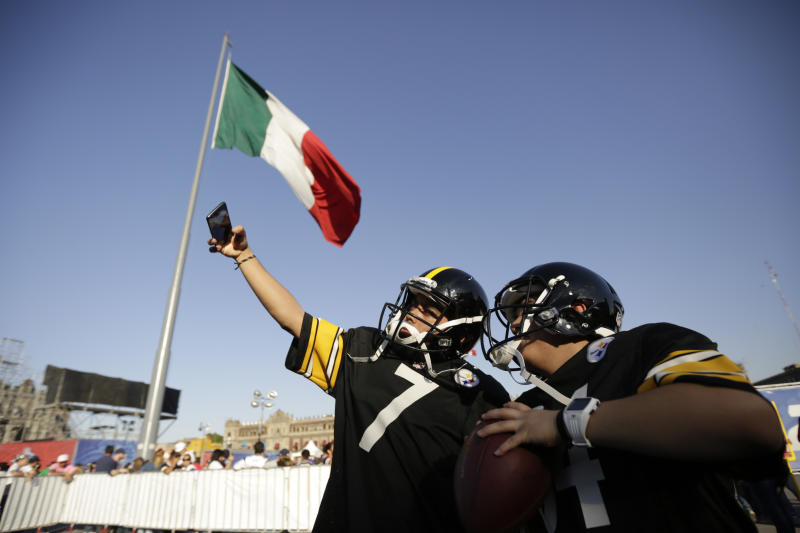 Fans pose wearing Steelers uniforms during NFL football's Fan Fest in Mexico City's main square, the Zocalo. (AP)