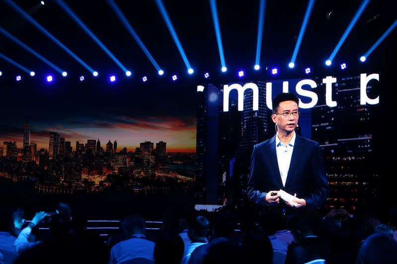 CEO of Ant Group Simon Hu is seen on a giant screen as he delivers a speech at the INCLUSION Fintech Conference in Shanghai