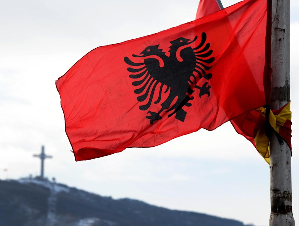 The flag of Albania is seen during the traditional dance performing of the members of the ethnic Albanian minority in Macedonia with traditional dresses, as they celebrate the National Albanian Flag Day and the anniversary of Albania's Independence, in Skopje, Macedonia on November 28, 2017. The Macedonian Albanian community, which makes up for around 25 percent of the 2.1 million population of Macedonia, are the biggest ethnic minority in the country. (Getty Images)