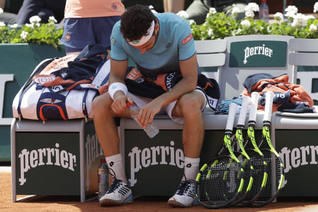 Italy's Marco Cecchinato looks down as he plays Austria's Dominic Thiem during their semifinal match of the French Open tennis tournament at the Roland Garros stadium, Friday, June 8, 2018 in Paris. (AP Photo/Alessandra Tarantino)