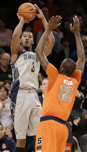 Georgetown's Mikael Hopkins shoots over Syracuse's Baye Keita during the first half of an NCAA college basketball game at the Big East Conference tournament Friday, March 15, 2013, in New York. (AP Photo/Frank Franklin II)
