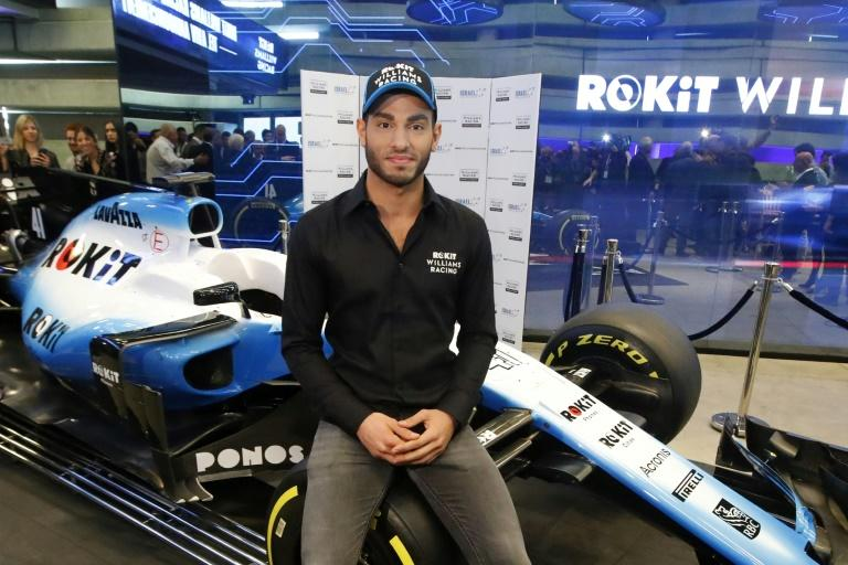 Israeli driver Roy Nissany poses next to his car after Williams announce him as their new F1 test driver