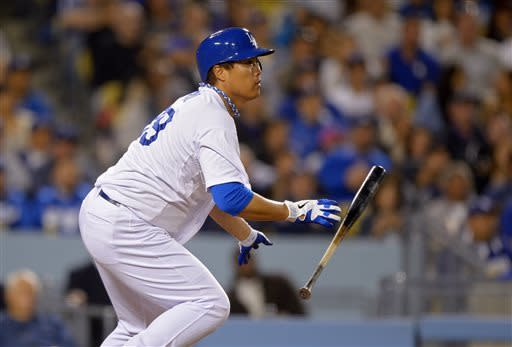 Los Angeles Dodgers' Hyun-Jin Ryu, of Korea, hits an RBI single during the third inning of their baseball game against the Colorado Rockies, Tuesday, April 30, 2013, in Los Angeles. (AP Photo/Mark J. Terrill)